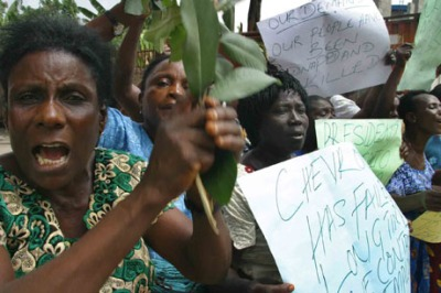 Demonstrators protest in Warri, Nigeria in 2005. The protesters demonstrated against what they claim to be the shooting death of activists and demanded that ChevronTexaco implement the July 17, 2002 Memorandum of Understanding and threatened to carry out more protest on ChevronTexaco oil facilities if their demands are not met.